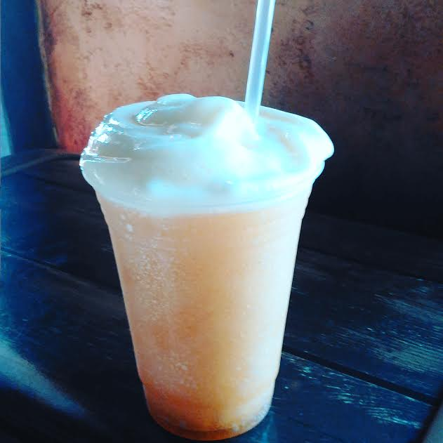 Frozen apple juice with marshmallow flavoring topped with a passion fruit-mango foam